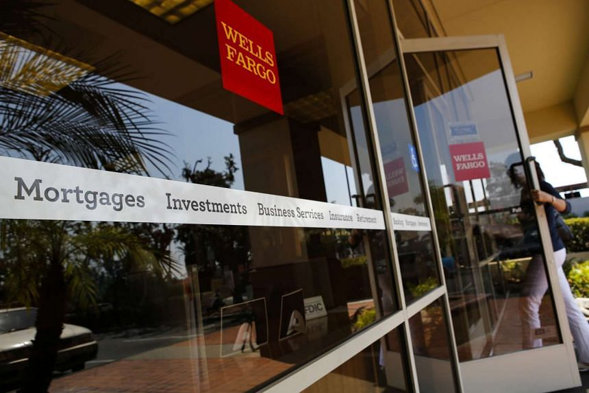 A customer enters a Wells Fargo & Co. bank branch in Hermosa Beach, California, US. US prosecutors have begun an investigation related to sales practices at Wells Fargo & Co.