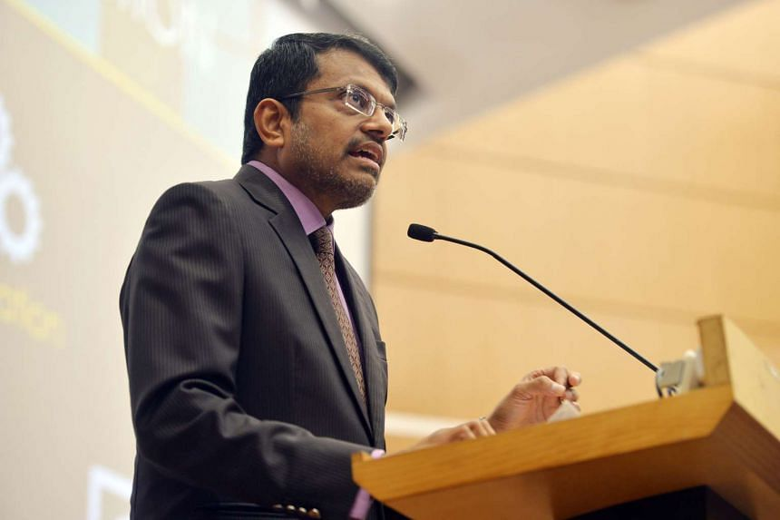 MAS managing director Ravi Menon speaks at a Fintech conference at the Singapore Management University on Aug 19, 2016.