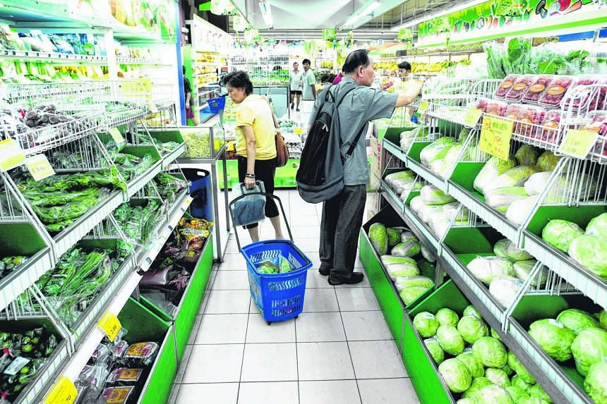 Shoppers in Sheng Siong Supermarket at 88 Tanglin Halt Road. Retail sales of medical goods & toiletries, mini-marts & convenience stores and supermarkets edged up by 0.3% to 4.5% year on year.