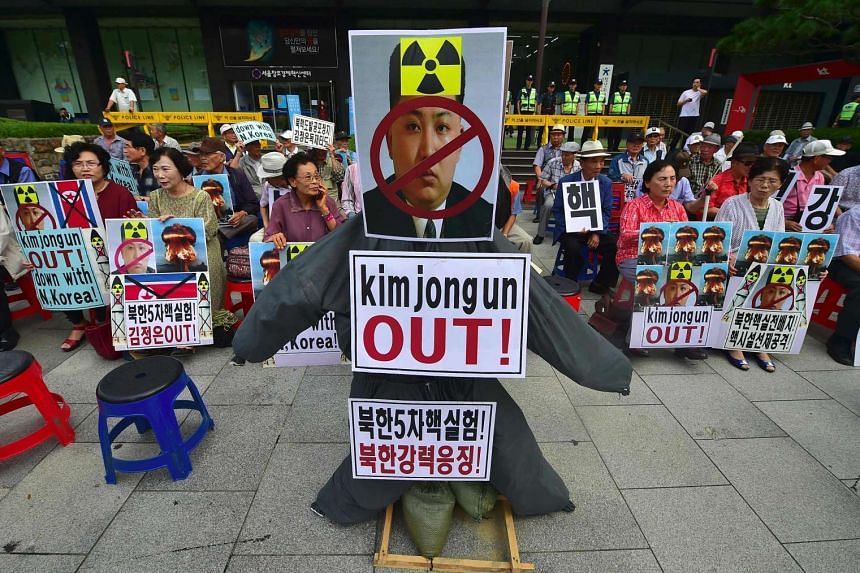 South Korean conservative activists set an effigy (centre) of North Korean leader Kim Jong-Un during a protest denouncing North Korea's nuclear test in Seoul on Sept 10, 2016.
