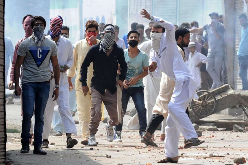 Indian Kashmiri protesters clash with Indian government forces during the Muslim festival of Eid-ul-Adha during a curfew in Srinagar on Sept 13, 2016.