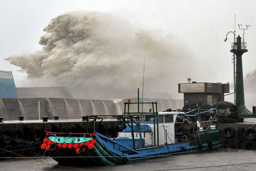 A huge wave breaking over port infrastructure as super typhoon Meranti lashes a fishing port in southern Taitung county on Sept 14, 2016.
