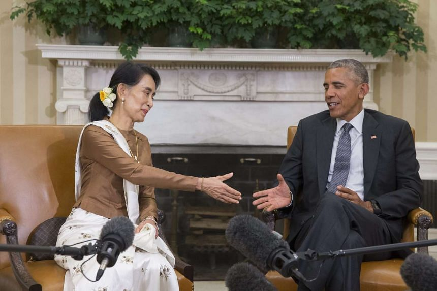 US President Barack Obama (right) shakes hands with State Counsellor of Myanmar Aung San Suu Kyi, during their meeting in the Oval Office of the White House in Washington, DC, USA, on Sept 14.