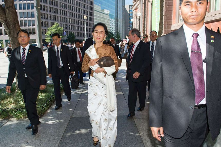Myanmar's State Counselor Aung San Suu Kyi, walks towards the Blair House to meet with Secretary of State John Kerry, on Sept 14.