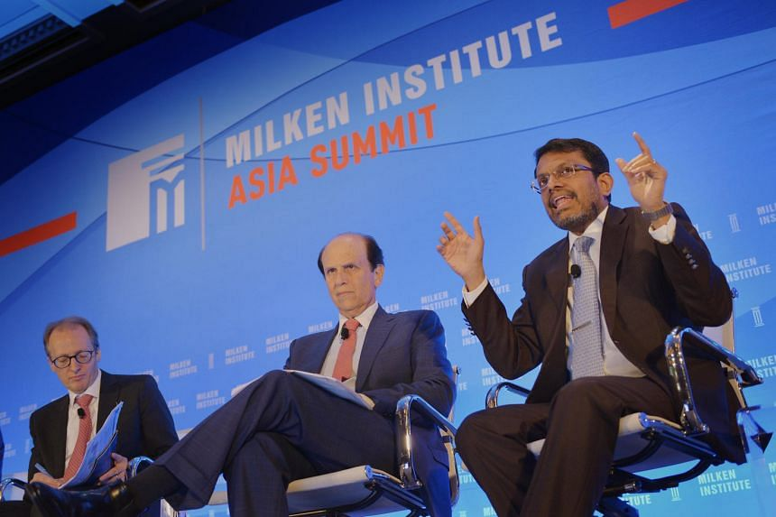 (From left) McKinsey Global Institute director Jonathan Woetzel; Mr Michael Milken, chairman of Milken Institute; and Mr Ravi Menon, managing director of the Monetary Authority of Singapore, at the Milken Institute Asia Summit 2016 at Four Seasons Ho