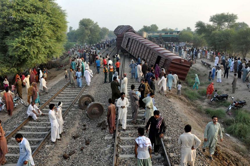 Locals at the scene where two trains collided near Multan, Pakistan on Sept 15, 2016.