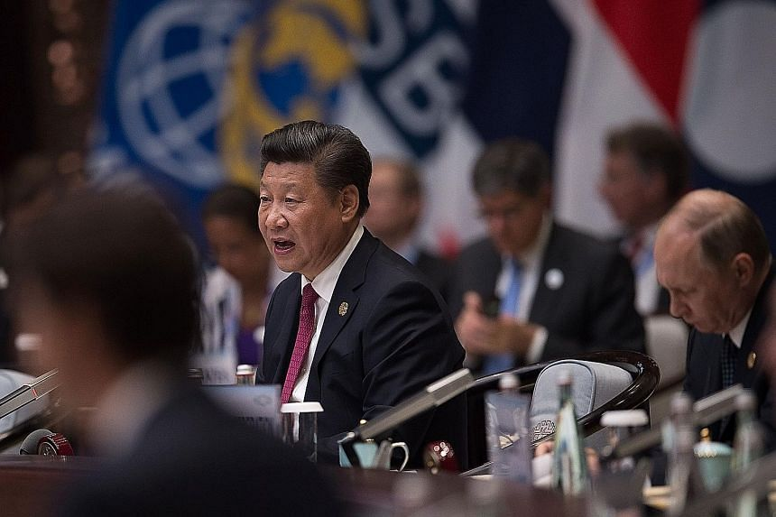 President Xi speaking at the opening of the G-20 summit in Hangzhou, China on Sept 4. He urged G-20 leaders to turn the group into an action team, instead of a talk shop.