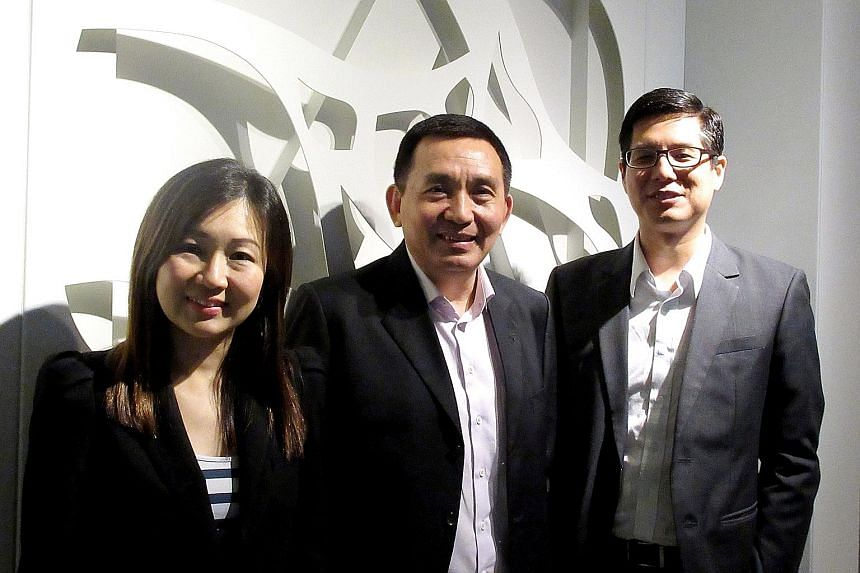 (From left) Koufu CFO Ms Chua; Mr Koh, the Singapore Business Federation's assistant executive director of the SME committee secretariat and capacity-building division; and Reebonz CFO Mr Cheah at the release of the American Express survey results ye