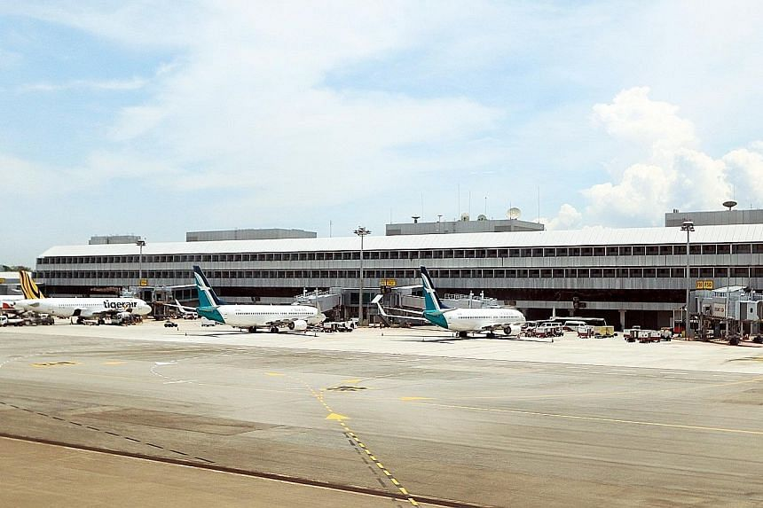Changi Airport has split some of its terminal gates at T2 so that two small planes, instead of just one aircraft, can be docked at any one time. This minimises the need to ferry travellers by bus to and from their planes.