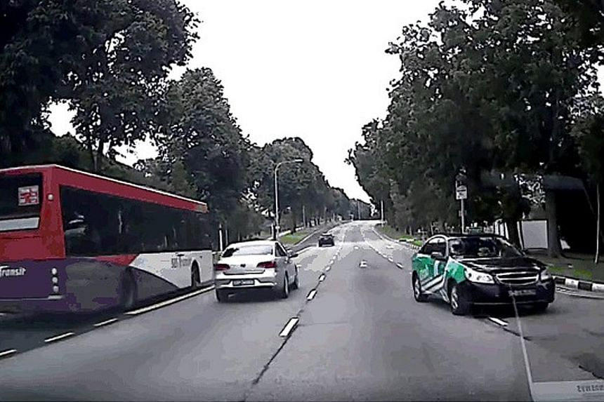 A screengrab from a video clip showing an SMRT taxi going against traffic in Sims Avenue East. The taxi company said that it has since taken action against the errant driver.