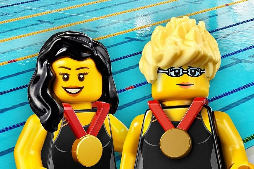 Swimmers Yip Pin Xiu and Theresa Goh's exploits, winning gold and bronze respectively, have earned them Lego mini-figures in their image.
