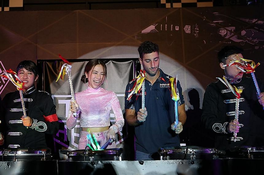 Above: Red Bull driver Daniel Ricciardo preparing to test the Ricciardo N35-RS kart at the KF1 Karting Circuit, where his own kart brand was launched. Ricciardo and singer-songwriter G.E.M. at a TAG Heuer event yesterday, playing drums together follo