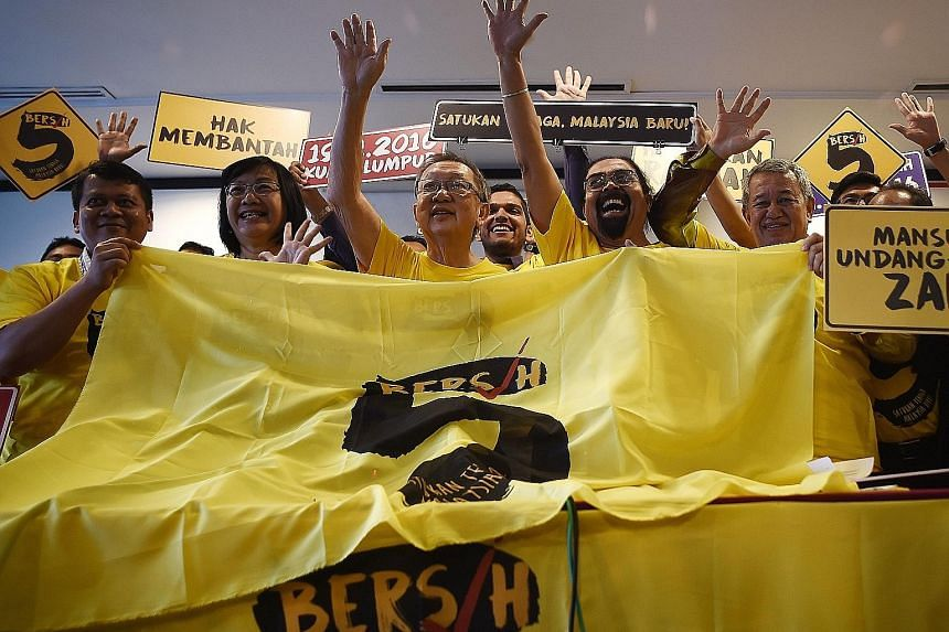 Ms Maria Chin Abdullah (second from left), Bersih's chairman, with other activists following a press conference in Kuala Lumpur yesterday. The November rally will be the second in 15 months that aims to oust Datuk Seri Najib over claims that more t