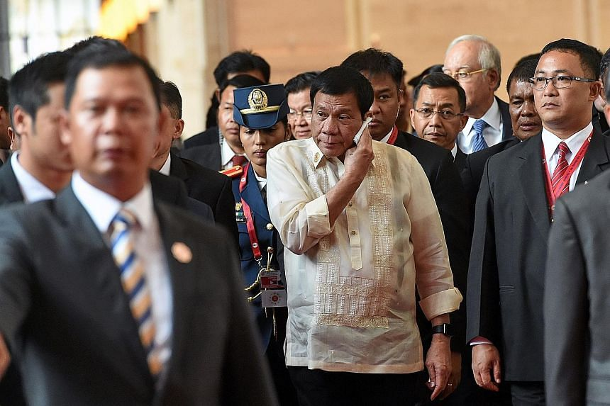 Mr Rodrigo Duterte (above centre) on his way to the closing ceremony for the Asean Summit in Vientiane last Thursday. Mr Barack Obama (below) leaving after the closing ceremony. The three-day summit was Mr Duterte's first Asean outing, but the impression