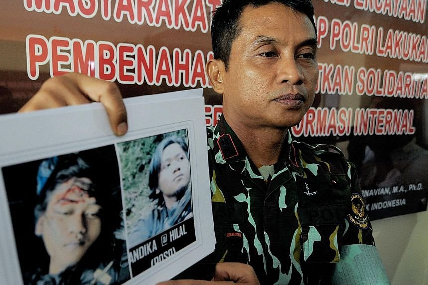 (Above) An Indonesian police spokesman giving details of the joint operation yesterday between the police and the military in which a member of the militant group, the Eastern Indonesia Mujahideen, was killed and its leader Basri (below) was captured