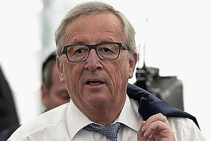 Mr Jean-Claude Juncker (above), president of the European Commission, delivered his State of the Union speech at the European Parliament (top) in Strasbourg, France, yesterday.