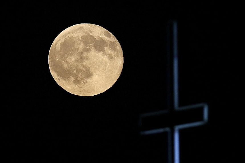 A full moon over Cyprus on Aug 18. University of Tokyo scientists found high tidal stress levels before big quakes in the last few decades.