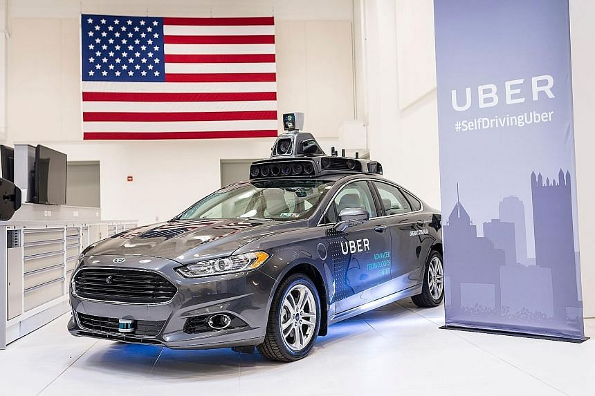 Four of the Ford Fusion hybrids, with their ungainly rooftop load of technology, were to be deployed yesterday on the challenging roads of Pittsburgh, Pennsylvania, steering themselves to pick up regular Uber passengers. Uber has at least a dozen mor