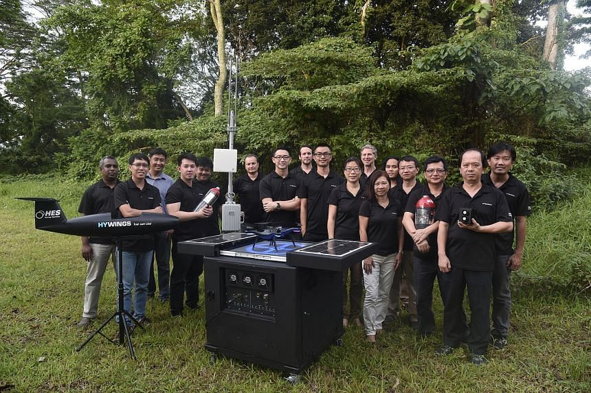H3 Dynamics' Mr Wankewycz (sixth from left) and his team with their products. The Singapore firm makes unmanned aerial vehicles, portable power systems and drones.