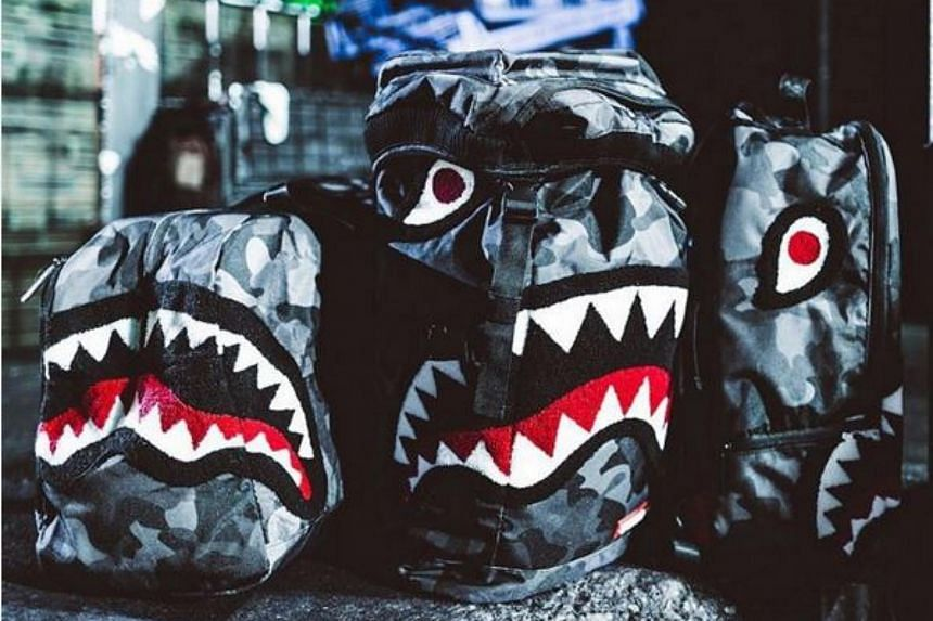 Sprayground backpacks with shark designs.