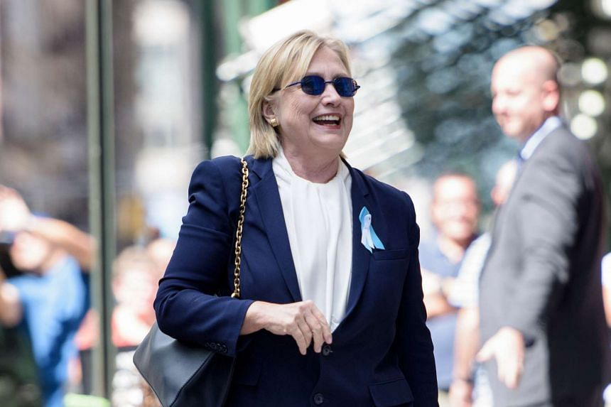 Mrs Hillary Clinton leaves her daughter's apartment building in New York on Sept 11, 2016.