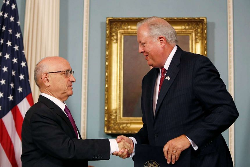 Israeli Acting National Security Adviser Jacob Nagel (left) and US Undersecretary of State Tom Shannon shake hands after signing the pact.