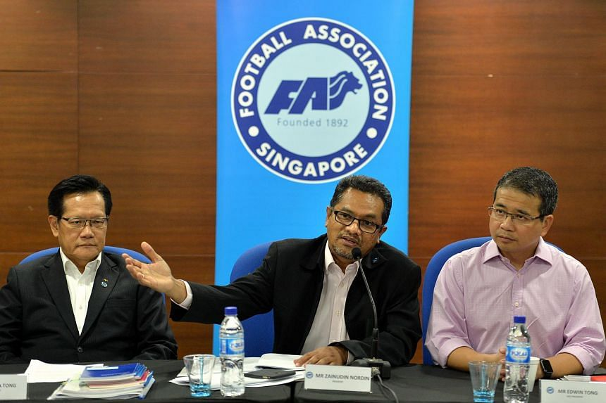 Football Association of Singapore (FAS) president Zainudin Nordin (centre) flanked by his vice presidents Lim Kia Tong (left) and Edwin Tong, speaking to media on Dec 29, 2015.