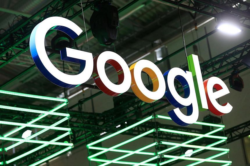 The Google Inc logo hangs illuminated over the company's exhibition stand at the Dmexco digital marketing conference in Cologne, Germany.