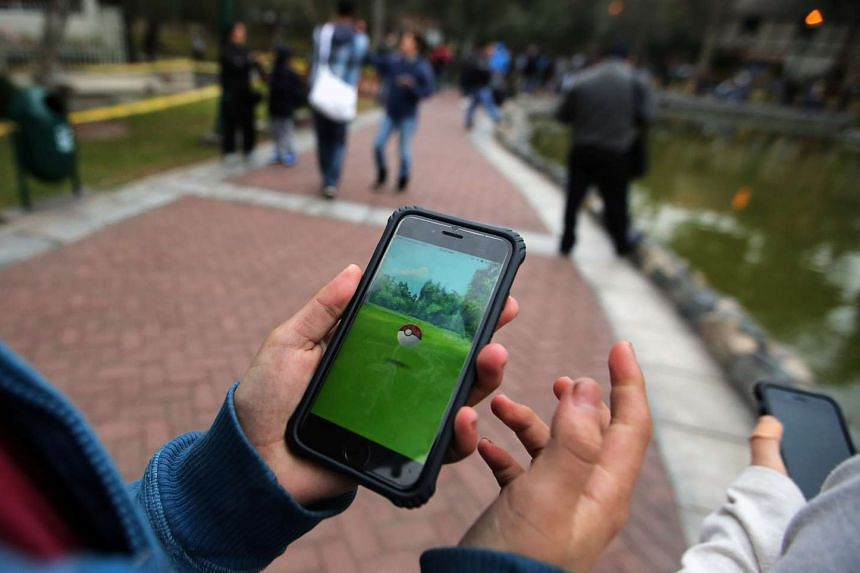 People play Pokemon Go at El Olivar park in San Isidro district of Lima, Peru on Sept 2, 2016.