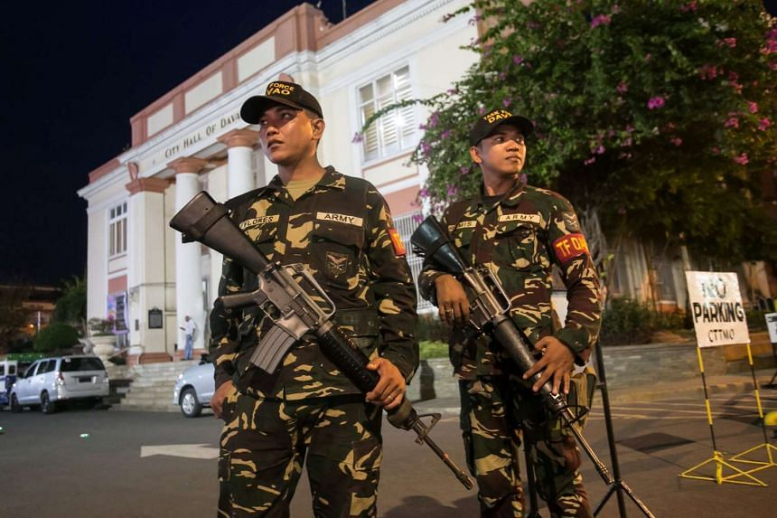 Military personnel standing guard in front of the city hall in Davao City, on Sept 4, 2016.