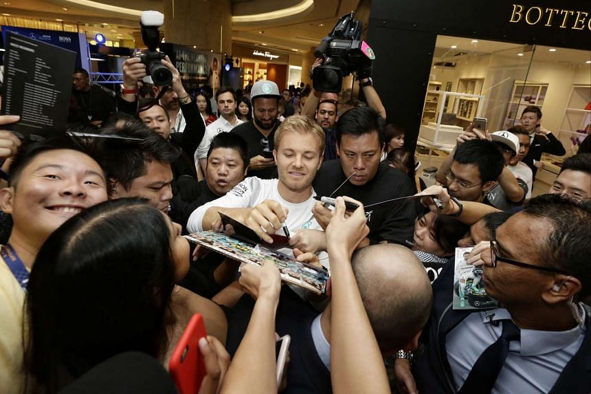 Nico Rosberg signing autographs for fans during an event at ION Orchard on Sept 15, 2016.