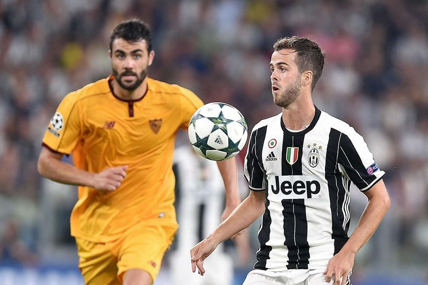 Juventus' Miralem Pjanic (right) in action during the match.