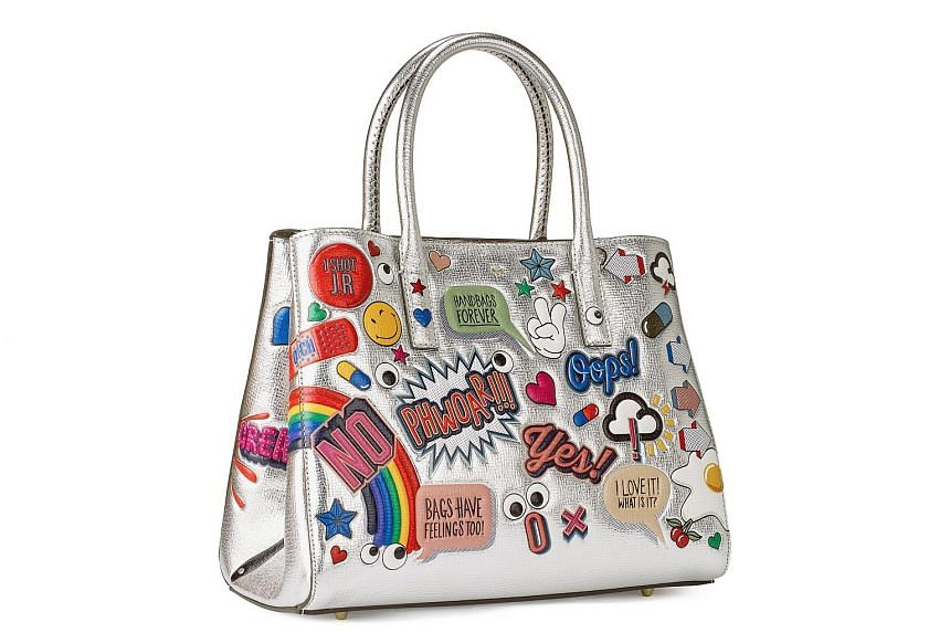Anya Hindmarch's Ghost Cross-Body and All Over Stickers Small Featherweight Ebury (above).