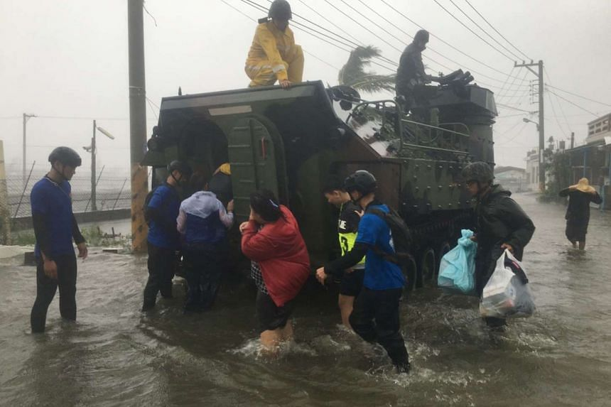 Residents affected by super typhoon Meranti being evacuated on a military armoured vehicle in southern Pingtung county on Sept 14, 2016