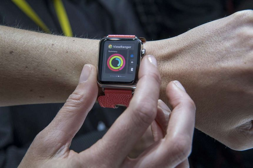 An attendee displays a new Apple Watch 2 at an event in San Francisco, California, on Sept 7, 2016.