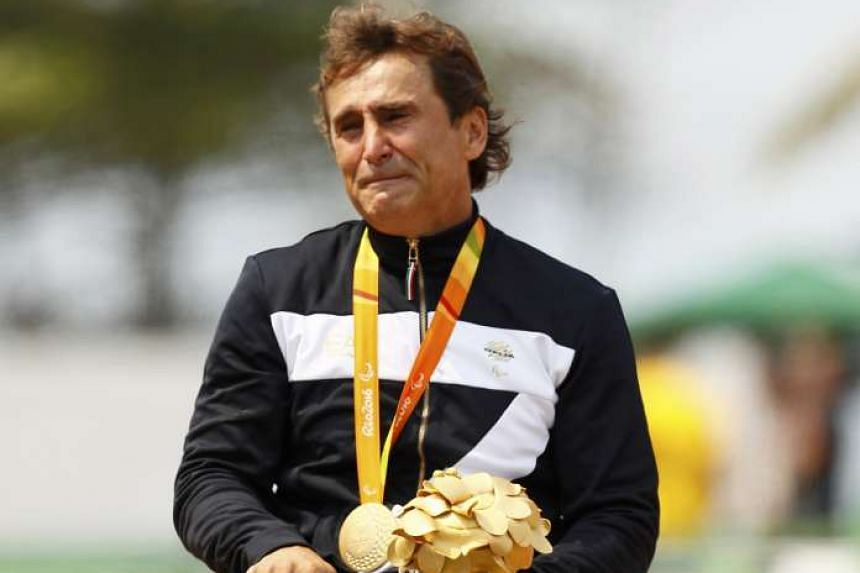 Gold medalist Alex Zanardi of Italy poses with his medal.