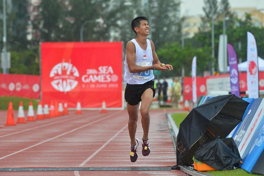 Singapore's Ashley Liew reacts as he crosses the finishing line to place 8th in the Men's Marathon in the 28th SEA Games on June 7, 2015.