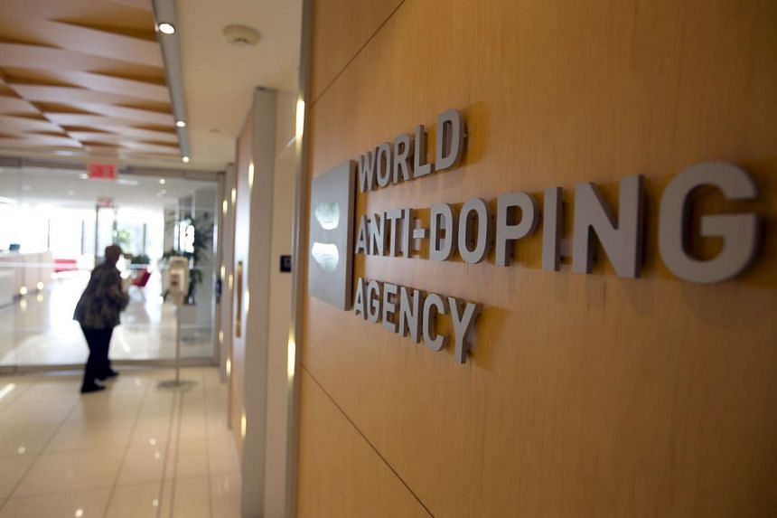 A woman walks into the head office of the World Anti-Doping Agency in Montreal, Quebec, Canada.
