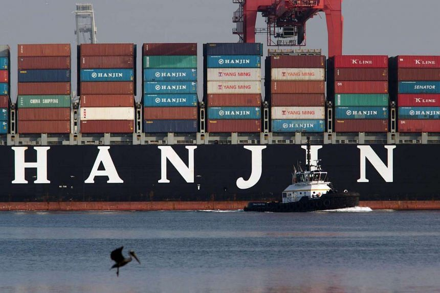 A tug boat pulling away from the Hanjin Greece container ship after it docked for unloading at the Port of Long Beach, California.