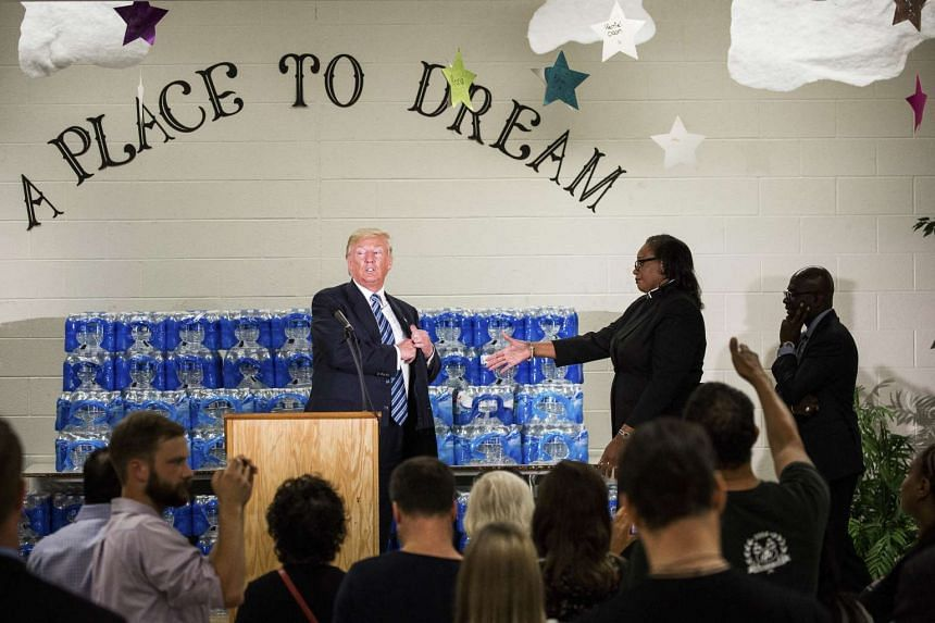Donald Trump is interrupted by Pastor Faith Green Timmons, of Bethel United Methodist Church, while speaking at the church in Flint on Sept 14, 2016.