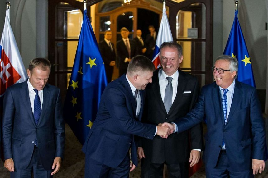 (From left) President of the European Council Donald Tusk, Slovak Prime Minister Robert Fico, Slovak President Andrej Kiska, and President of the European Commission Jean-Claude Juncker, before their informal dinner on the eve of the European Union s