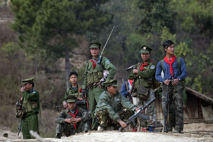 Soldiers of the Taaung National Liberation Army, a Palaung ethnic armed group, standing guard at a village in Mantong township, Myanmar in 2014.