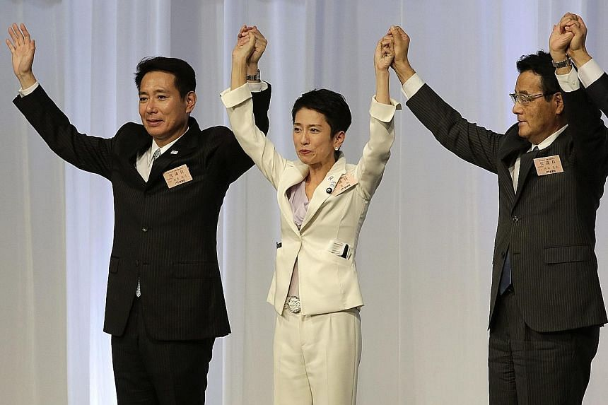 Ms Renho with a competitor for the post, Mr Seiji Maehara (left), and present party chief Katsuya Okada at the Democratic Party's convention yesterday. The current ruling party has never had a female leader.