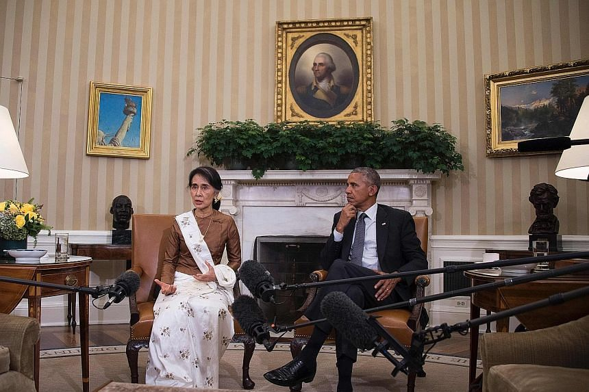 Ms Suu Kyi with Mr Obama at the White House on Wednesday. Both leaders feel Myanmar is now in a position to open up to investors keen to take part in its economy, which is expected to grow 8.4 per cent this year.