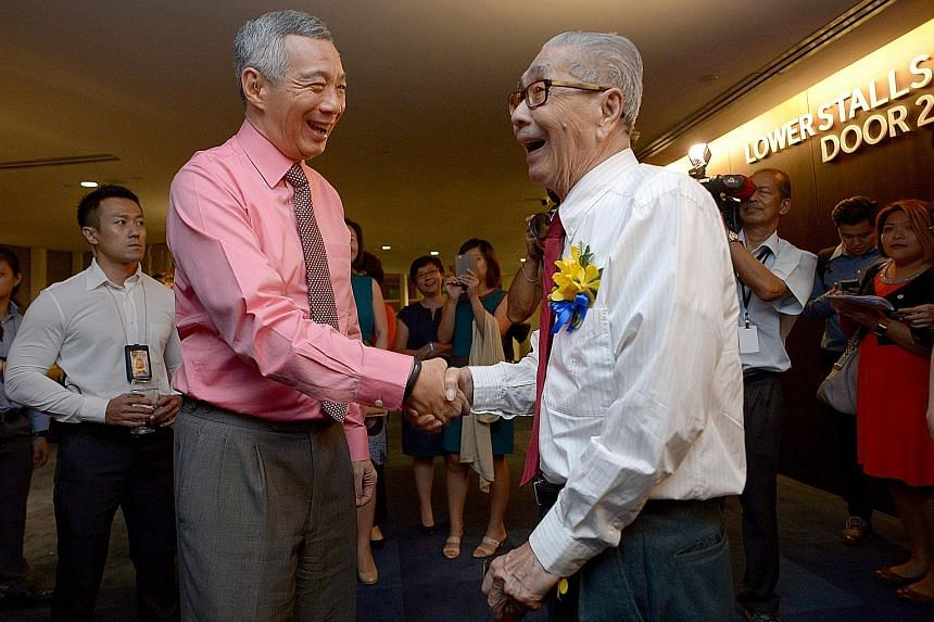 PM Lee with his father's old classmate, Mr Ceylon Lee, 94, who attended Telok Kurau English School, as the school was then called, as well as Raffles Institution with the late Mr Lee Kuan Yew.