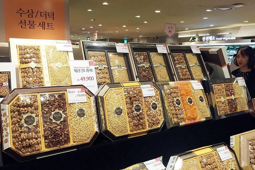 Gift sets priced below 50,000 won (S$60) - the limit set by an impending anti-graft law for gifts for civil servants, teachers and journalists - on display at a department store before the three-day Chuseok holiday which began on Wednesday.