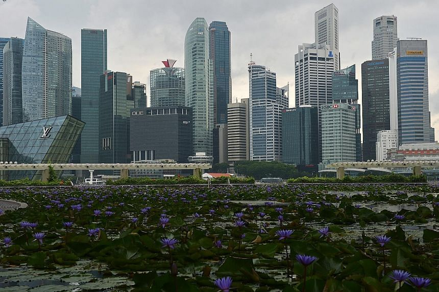 Skyline of Singapore's central business district (above). According to Ms Alice Tan of Knight Frank Singapore, the high influx of about six million sq ft gross floor area of office space island-wide for this year and next year will weigh on rentals i