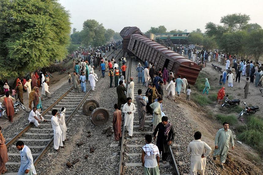 At least four people were killed and more than 100 injured when two trains collided in central Pakistan early yesterday, officials said. The accident occurred near the city of Multan around 2.30am when the Karachi-bound Awami Express passenger train
