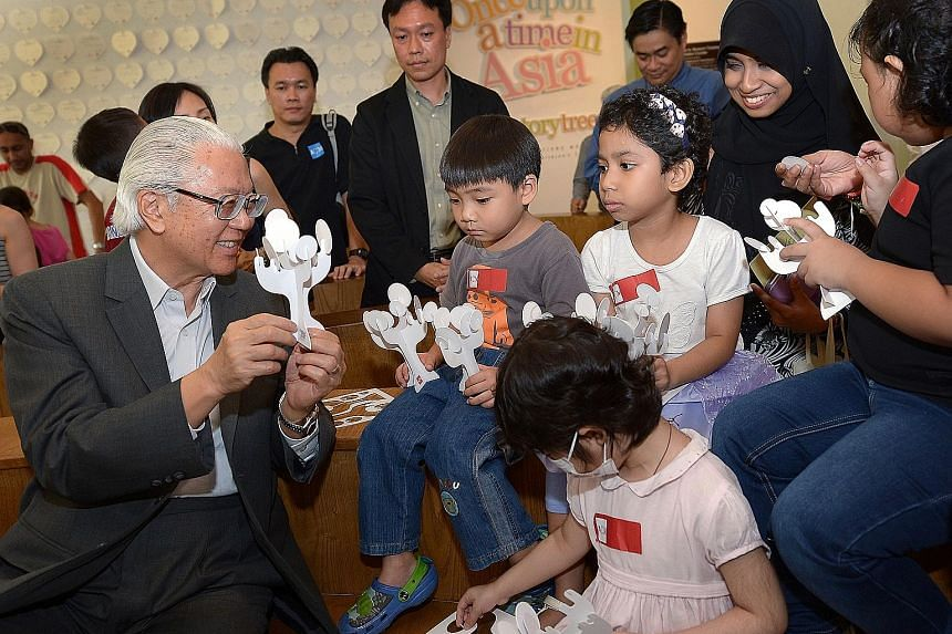 President Tony Tan Keng Yam interacting with children at a 2014 exhibition. Every Singaporean has to be able to identify with the president, said the Government.