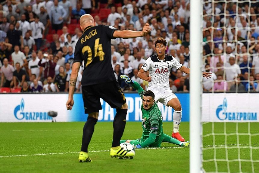 Tottenham striker Son Heung Min (right) beats Monaco goalkeeper Danijel Subasic but Andrea Raggi clears off the line during the Champions League group E match. The French league leaders won 2-1, leaving Spurs on one win at the new Wembley in six appe